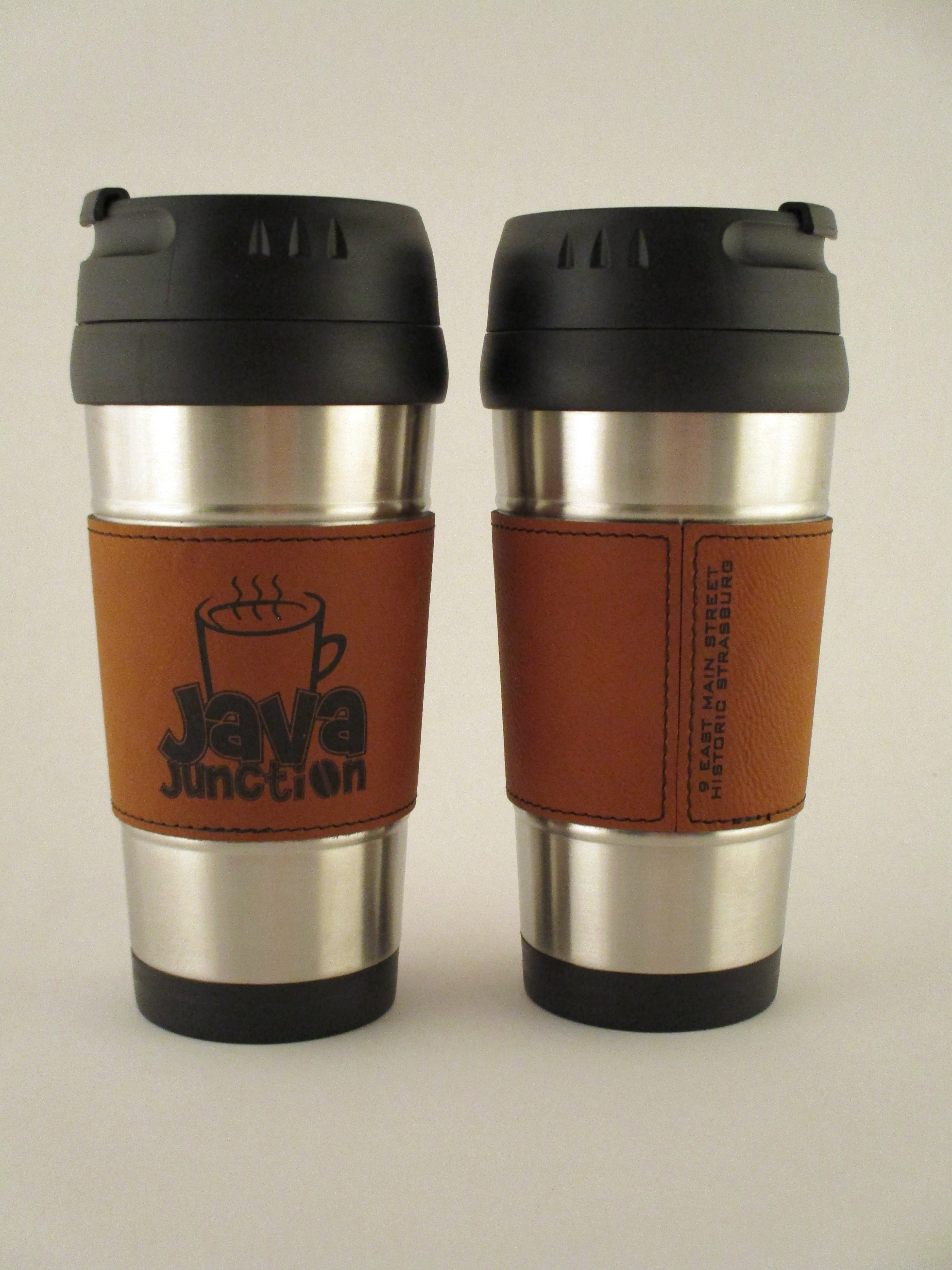 Stainless travel mug with leatherette sleeve